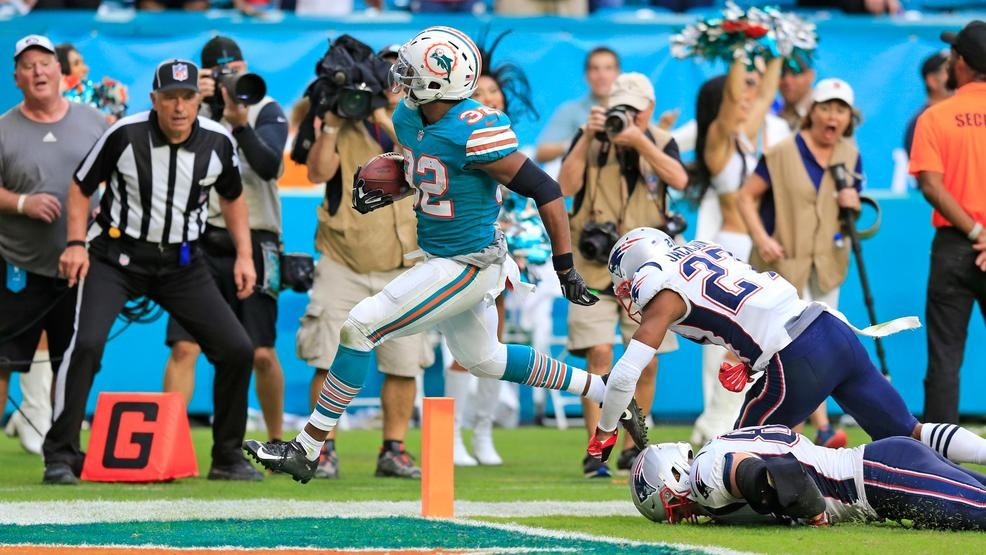 6ff20856f Miami Dolphins running back Kenyan Drake (32) scores to defeat the New  England Patriots at Hard Rock Stadium in Miami Gardens on Sunday, Dec. 9,  2018.